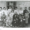 15. BROOKS Family. Now we move into the family of Margaret Brooks Powers. This photo was probably taken before she married James Davis in Feb 1909. Margaret is in the back, at left. Seated in front are her grandparents and parents.<br /> <br /> Whoever wrote 'circa 1914' was entirely incorrect. It probably dates to 1908.    From back, left, Margaret Deborah; Mary Katherine; Zillie L., probably; Martha Coleen; Eula Belle; Nora (Rufus'wife), and Rufus holding their daughter Gracie Dallis, b. March 1, 1907; n front of Nora is Charles' daughter Rosie Lear, b. 1897.   Front row, from left, Charlie Douglas, b. 1900; John Brooks and wife Elizabeth 'Betty' Hill Brooks; John's son Charles Brooks, holding his daughter Myrtle, b. 1904; behind Charles is his daughter Priscilla Caroline, b. 1895;  Charles' son Walter Samuel, b. 1902; Charles' wife Nancy Jane Boyd Brooks. Possibly she is holding Joseph A. who was listed in the 1910 census as three years of age. Joseph is not mentioned again in any family records, but there was an Arlie. See further notes on Arlie in later pages here.  <br /> <br /> Concerning the two children being held by Mary and Zillie in the back row, it is difficult to tell who they are. I think 1908 is a logical date for this photo. Charles holds his daughter Myrtle who was born in July 1904, making her about four years old in this picture. Her brother Walter, born in June 1902 and looks to be about six, here.<br /> So, working with the 1908 date, who can Mary and Zillie be holding?<br /> <br /> In the 1910 census, living in Charles and Nancy's household, was their granddaughter, Rachel G., born about September 1909. Her parents are not identified. She was also with the family in 1920, then disappears into history. But I don't think she was yet born if the photo was taken in 1908.<br /> <br /> Charles's daughter Mary Katherine, born 1884, was married in 1905 to Roy M. Kestner. They had a son Russell E., born about 1907 and oddly, was listed incorrectly as a