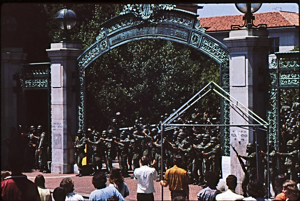 5*Tue, May 20, 1969<br /> *People: line of cops <br /> Subject: Sather Gate<br /> *Place: Sather Gate<br /> Activity: ppp<br /> Comments: I didn't realize why they had gas masks on. Soon found out.