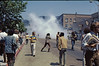"5*Thu, May 15, 1969<br /> *People: people yelling back ""what the fuck is going on?""<br /> Subject: tear gas dispersed<br /> *Place: Bancroft/Telegraph<br /> Comments: person (cop?) in cloud with gas mask. #1 song=""Let the Sunshine In"""