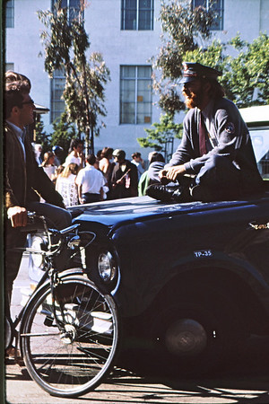 4*Thu, May 15, 1969<br /> *People: mailman, spectator<br /> Subject: on car hood<br /> *Place: Bancroft<br /> Activity: ppp<br /> Comments: hat and tie