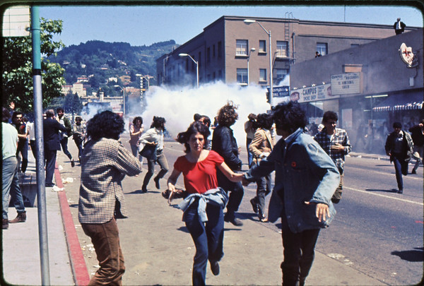 5*Thu, May 15, 1969<br /> Subject: running from tear gas explosion*Place: Bancroft/Telegraph, Berkeley Comments: The 1st tear gas of People's Park protest (ppp). Police coming up Telegraph to campus - on right.  Observers on roof.  I was photographed here and am in the 1969 Book on PP.11 of my photos are in the 2009 book on PP.