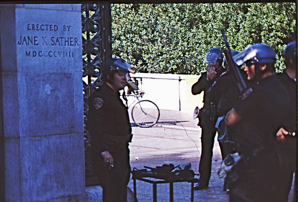 4*Thu, May 15, 1969<br /> *People: cops taking break<br /> Subject: inscription<br /> *Place: Sather Gate<br /> Activity: <br /> Comments: Smoking and blowing nose. Shotguns ready. Reloading.