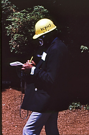 5*Tue, May 20, 1969<br /> *People: KQED reporter<br /> Subject: writing notes<br /> *Place: Sather Gate<br /> Activity: ppp<br /> Comments: wearing gas mask