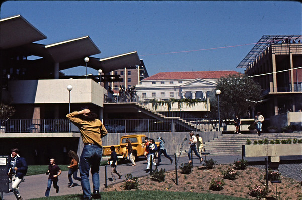 5*Thu, May 15, 1969<br /> *People: cops spraying, guy with hand on head<br /> Subject: gassing<br /> *Place: lower Sproul Plaza<br /> Activity: ppp<br /> Comments: fogger (pepper gas) aimed down stairs.  Shotgun aimed at photographer - me.