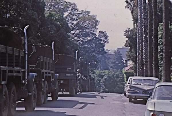 "Mon, May 19, 1969<br /> *People: National Guard<br /> Subject: trucks<br /> *Place: ""Holy Hill"" north side<br /> Activity: ppp<br /> Comments: overlooking campus"