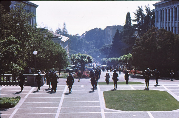 4*Thu, May 15, 1969<br /> *People: cops, filmer<br /> Subject: shotguns<br /> *Place: center of campus<br /> Activity: ppp<br /> Comments: