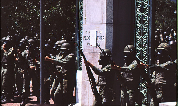 5*Tue, May 20, 1969<br /> *People: cops<br /> Subject: <br /> *Place: Sather Gate<br /> Activity: ppp<br /> Comments: bayonets, gas masks, guns, helmets - those students must be dangerous
