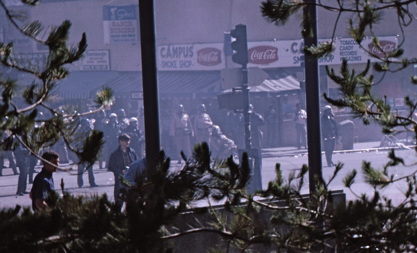 3*Thu, May 15, 1969<br /> *People: cops securing <br /> Subject: haze <br /> *Place: Bancroft/Telegraph<br /> Activity: ppp<br /> Comments: Gas at Campus Smoke Shop - get it?