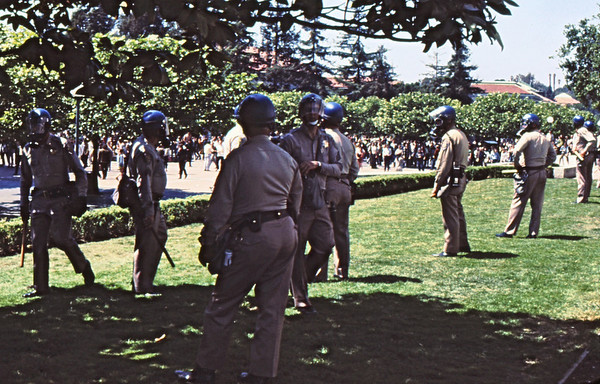 4*Thu, May 15, 1969<br /> *People: 9 cops<br /> Subject: in line, batons out<br /> *Place: Sproul grass<br /> Comments: now on campus, specifically Sproul Plaza in front of Sproul Hall.
