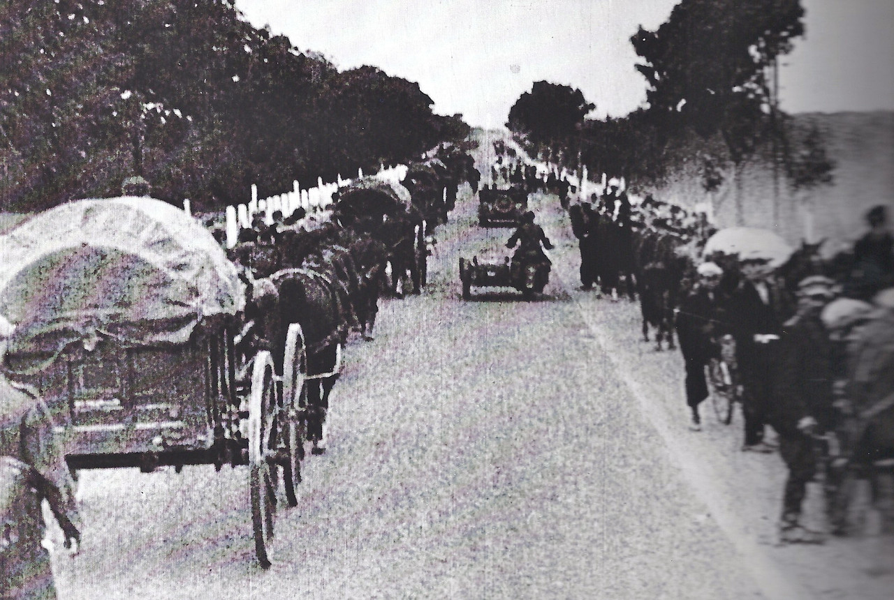 A column of Jews streaming into Warsaw from surrounding towns after they had been ordered to relocate to the Ghetto.
