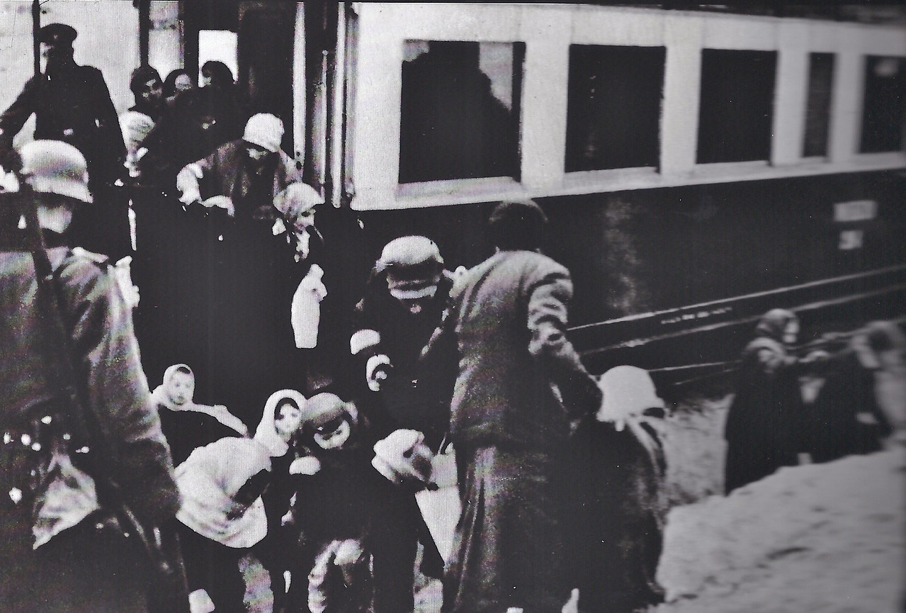 """The nazis """"helping"""" the kids board the train for relocation"""