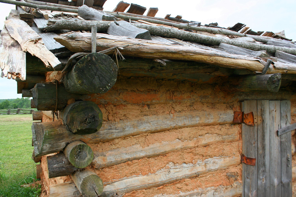 The huts provided very basic shelter for those building the fort.  They were constructed with rough hewn logs, cedar shakes, and a straw/mud mortar...