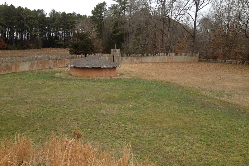 Looking down at the burial hut and north gate from atop the temple mound...