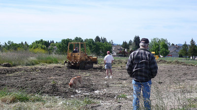 Jessie's crew, with Al's dozer, leveling site for our concrete pad!