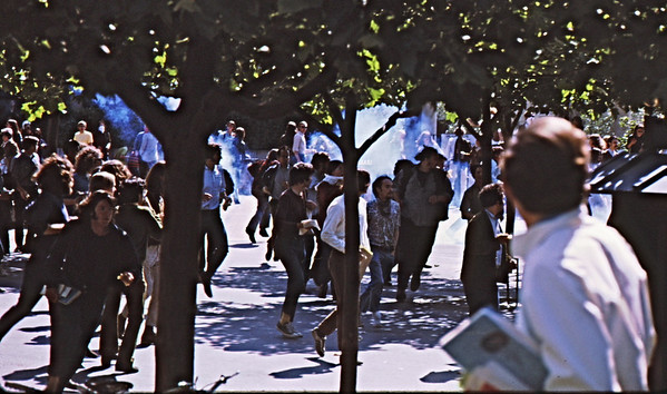4*Wed, Apr 15, 1970<br /> *People: many students<br /> Subject: raining CS tear gas canisters<br /> *Place: Sproul Plaza<br /> Activity: protest<br /> Comments: running, jumping