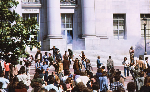 4*Wed, Apr 15, 1970<br /> *People: crowd<br /> Subject: tear gas thrown back <br /> *Place: Sproul Hall<br /> Activity: <br /> Comments: several victory salutes