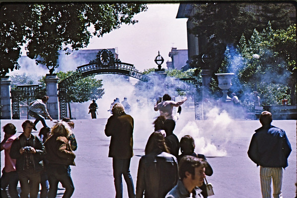 5*Wed, Apr 15, 1970<br /> *People: cops and students<br /> Subject: kicking tear gas canister<br /> *Place: Sather Gate<br /> Activity: ROTC protest<br /> Comments: