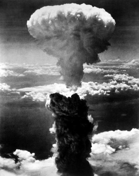 A dense column of smoke rises more than 60,000 feet into the air over the Japanese port of Nagasaki, the result of an atomic bomb, the second ever used in warfare, dropped on the industrial center August 8, 1945, from a U.S. B-29 Superfortress.  (OWI)<br /> NARA FILE #:  208-N-43888<br /> WAR & CONFLICT BOOK #:  1242