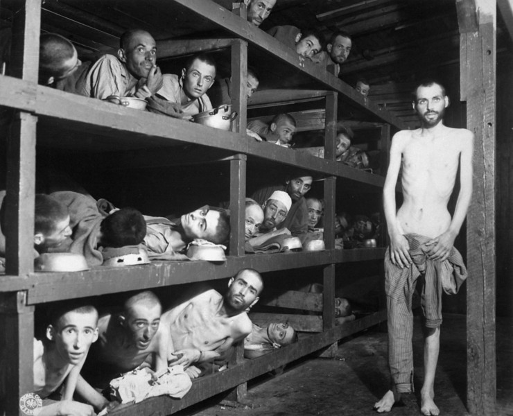 These are slave laborers in the Buchenwald concentration camp near Jena; many had died from malnutrition when U.S. troops of the 80th Division entered the camp.  Germany, April 16, 1945.  Pvt. H. Miller.  (Army)<br /> NARA FILE #:  208-AA-206K-31<br /> WAR & CONFLICT BOOK #:  1105