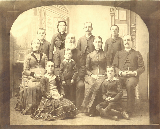 "John Quayle family, taken in Ishpeming, MI in about 1887. Rear row, L to R:  James (B: 3 NOV 1874, D: 17 NOV 1935) Mona (B: 1 NOV 1870, D: 25 APR 1966) John Jr. (B: 29 MAR 1864, D: 21 SEP 1929) William (B: 16 NOV 1872, D: 7 NOV 1939) Middle row, L to R: Margaret (Bridson) Quayle John Quayle Catherine (Quayle) Buzzo (""Aunt Kate"") (B: 8 APR 1867, D: 25 FEB 1920) Richard Quayle (""Uncle Dick"") (B: 21 JUL 1862, D: 6 JUL, 1934) Front row, L to R: Anna Margaret (Quayle) Kennaugh (""Aunt Annie"") (B: 17 AUG 1876, D: 20 MAR 1955) Thomas Quayle (B: 28 AUG 1882, D: 12 OCT 1890) Phillip Quayle (B: 15 AUG 1879, D: 18 NOV 1954)"