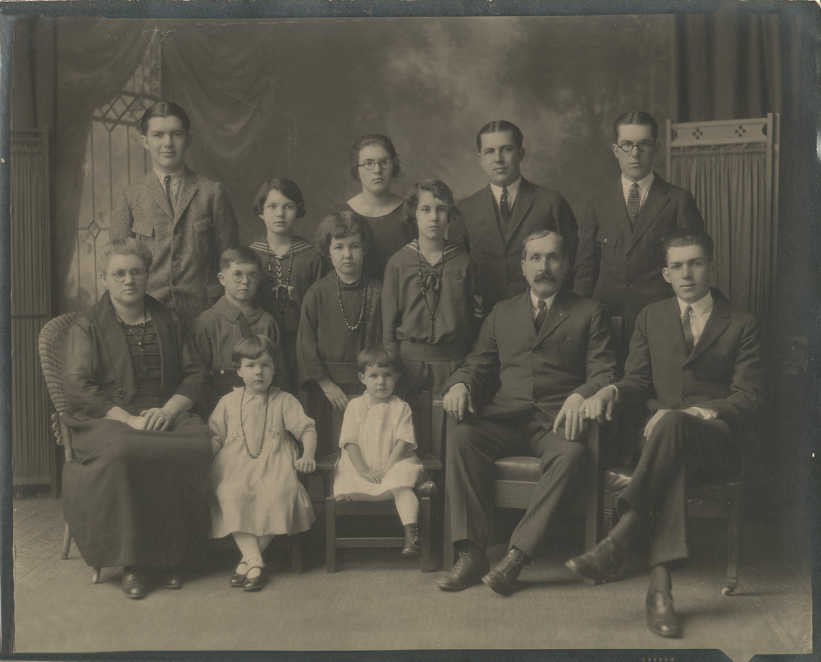 The Quayle Family - 1923<br /> Back row, L to R<br /> Malcolm, Borghild, Jennie, Herbert, Norman<br /> Front/Middle row<br /> Jennie, Arthur, Margaret, Florence, William, William<br /> Front row<br /> Ruth, Agnes