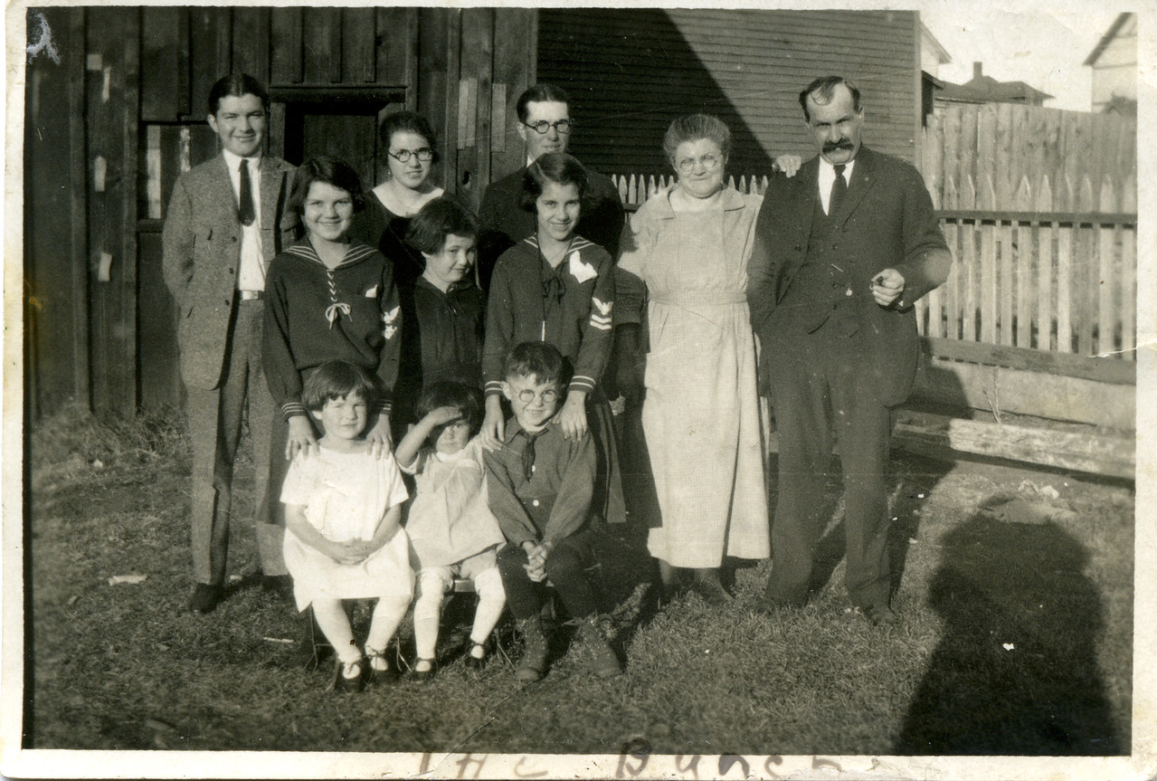 Rear row, L to R:<br /> Malcolm, Jenny, Norman, Jenny, William<br /> Middle row, L to R:<br /> Florence, Margaret, Borghild<br /> Front row, L to R:<br /> Agnes, Ruth, Arthur