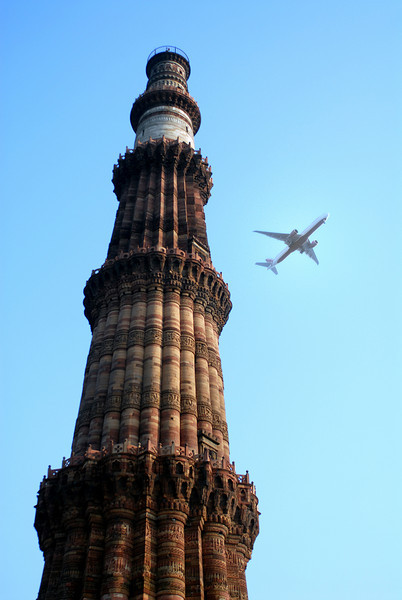 The Qutob Minar tower - over 220 feet tall and centuries old - with a modern jet flying by - old and new combined - it really reflects all of India in 2010.