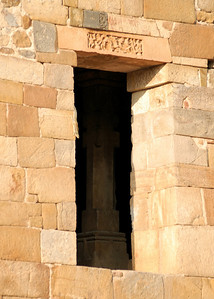 Doorway, above ground, at the Qutob Minar complex.  I think the sign above the door is interesting, I wish I knew what it said ...