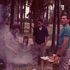 13. I think this was another cookout at Hunting beach. At right is Chaplain Herb Andy Johnson. The beauty being followed by smoke is his wife Bobbie.