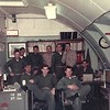 10. Two fuzzy pics of the Ops and Training crew. Wish I could remember their names. The major in the khaki shirt was in charge of the office. That's me at the back right.