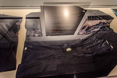 "Apologies for all the glare and reflection. This is the suit (folded pants on the left) Mr Regan wore when shot by John Hinckley. The jacket is laying open at 90 degrees to the right. The president was extremely upset in the hospital when they cut his ""brand new $1,000 suit"" off of him. It was the first time he had ever worn the suit."