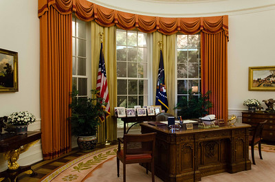 The Oval Office. This desk is a replica of the one Mr Reagan used and many presidents before and since him have used. The original is still in use at the White House. If you look closely at the bottom of the desk you will see a line parallel to and a few inches above the ground. That is where they increased the highth of the desk to accommodate Mr Reagan's size.