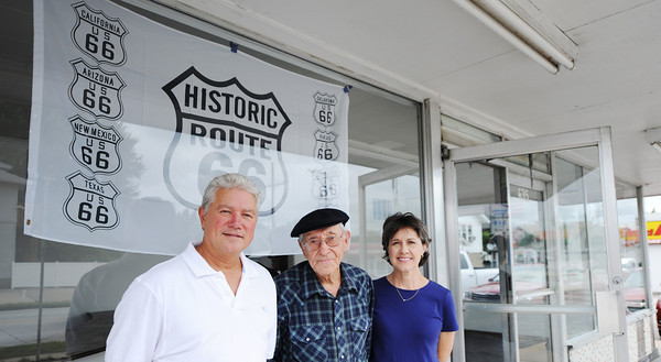 Globe/T. Rob Brown<br /> The Mr. Swiss family (from left) Tom Hills, Hugh Hills and Conni Lipe, all of Joplin, stand in front of the historic Route 66 hamburger and ice cream restaurant on West 7th Street in Joplin.