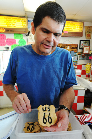 Globe/T. Rob Brown<br /> Charles Duboise, son of Dairy King owner Treva Duboise, shows off his Route 66 cookies, which he designed and bakes himself, Wednesday afternoon, July 24, 2013, at the Dairy King in downtown Commerce, Okla.