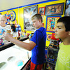 "Globe/T. Rob Brown<br /> Owner Larry Tamminen (left) takes and fulfills ice cream orders from customers Mason Jones (center) and Bobby Acevedo, both 14 and of Carterville, Tuesday evening, July 23, 2013, at SuperTam on 66 in Carterville. SuperTam on 66 is an ice cream parlor and Superman museum. ""We've been coming here since we were kids,"" Acevedo said."