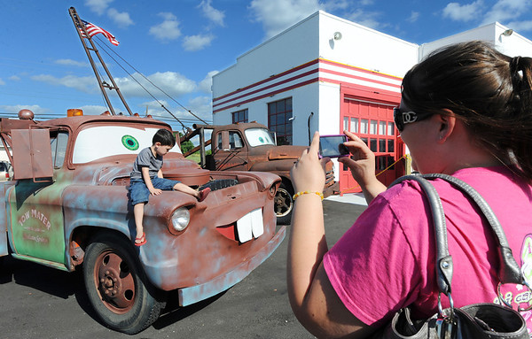 Globe/T. Rob Brown<br /> Trisha Robinson (right) of Joplin takes a photo of her 4-year-old son Trey Rossel as he sits on a Disney-Pixar prototype To Mater tow truck Wednesday evening, July 24, 2013, at Cars on the Route in Galena, Kan. The truck in the background is the original that Tow Mater was based on.