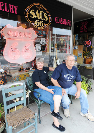 Globe/T. Rob Brown<br /> SACS 66 owners Steve and Cathy Bolek sit out front of their antique store Wednesday afternoon, July 24, 2013, in Baxter Springs, Kan.