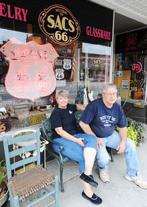 Globe/T. Rob Brown SACS 66 owners Steve and Cathy Bolek sit out front of their antique store Wednesday afternoon, July 24, 2013, in Baxter Springs, Kan.