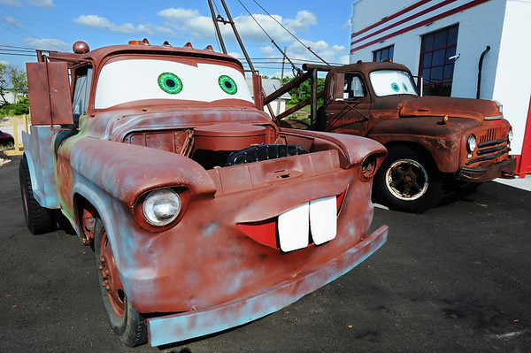 """Globe/T. Rob Brown<br /> A Disney-Pixar prototype Tow Mater tow truck (left) and the original (background) that Tow Mater was based on in """"Cars"""" Wednesday evening, July 24, 2013, at Cars on the Route in Galena, Kan."""