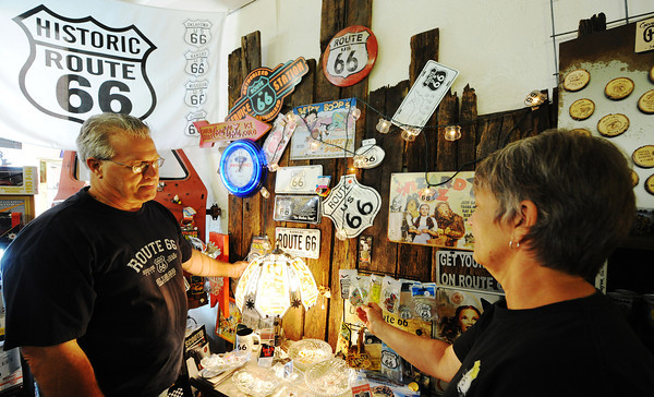 Globe/T. Rob Brown<br /> SACS 66 owners Steve and Cathy Bolek look through their antique store's stock of Route 66 memorabilia Wednesday afternoon, July 24, 2013, in Baxter Springs, Kan.