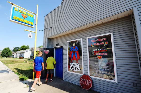 """Globe/T. Rob Brown<br /> Mason Jones (left) and Bobby Acevedo, both 14 and of Carterville, enter SuperTam on 66 Tuesday evening, July 23, 2013, in Carterville. SuperTam on 66 is an ice cream parlor and Superman museum. """"We've been coming here since we were kids,"""" Acevedo said."""