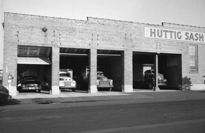 A fleet of delivery trucks in the garage at the Huttig Sash and Door Company factory in 1953. State Archives of Florida, Florida Memory, http://floridamemory.com/items/show/167285