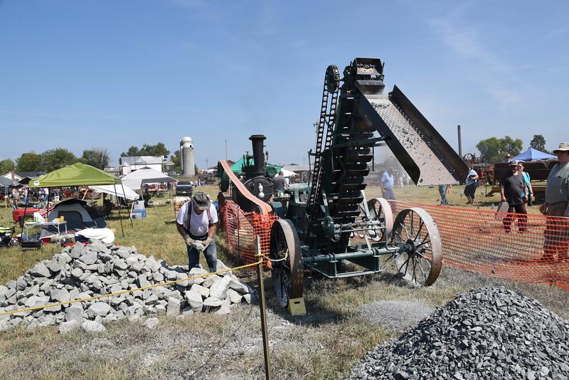 Crushing rocks.
