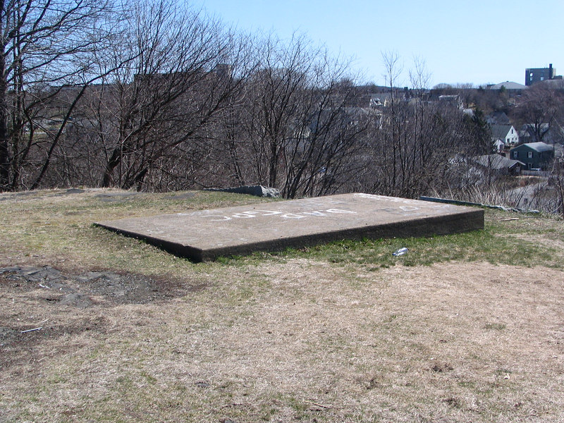 An odd cement pad at the top of the hill. Perhaps a monument to the deceased once stood here?