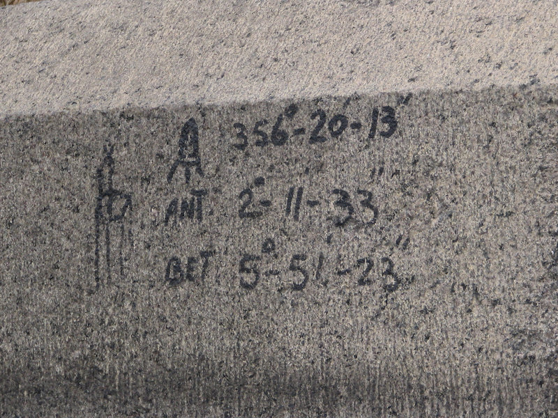 strange writing on the wall outside. it looks like coordinates for something.