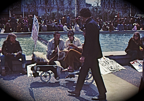4*Sun, Apr 6, 1969<br /> *People: many<br /> Subject: waiting for start<br /> *Place: civic center, San Francisco<br /> Activity: Peace March<br /> Comments: Easter; 3 wheel trike, stuffed horse, sign