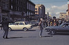 3*Sun, Apr 6, 1969<br /> *People: cop, flautist<br /> Subject: intersection, cars<br /> *Place: Van Ness, san francisco<br /> Activity: peace<br /> Comments: