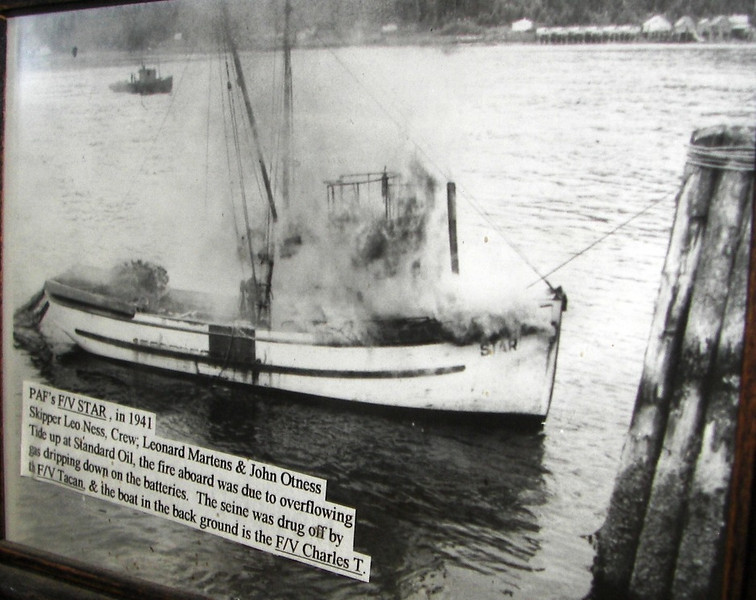 Star, Charles T. in Petersburg. Star on fire in 1941 tied to Standard Oil fuel dock in Petersburg; Skipper Leo Ness; crew was Leonard Martens & John Otness; later owners of Star were Leonard Martens and Henry Davis. In photo Tacan is saving the net, pulling it off the stern; the net was saved, the fire then extinguished and the Star was re-built.  Star built 1916, Seattle.