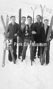 Five boys (L-R: Parrish, ?, Henrickson, Junior Thompson, and Adamson) pose with their skis and a trophy, ca.1940s (Image: digi-7-91, Mel Fletcher Collection)