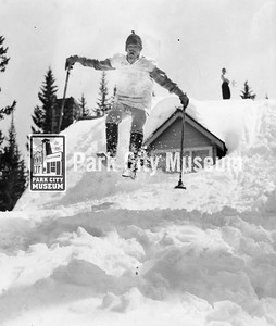 Park City skiing pioneer Mel Fletcher jumps off a snow-covered house, ca.1952 (Image: digi-7-85, Mel Fletcher Collection)